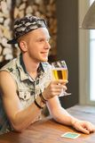 Happy man drinking beer at bar or pub Royalty Free Stock Photography
