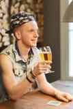 Happy man drinking beer at bar or pub Royalty Free Stock Photography