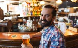 Happy man drinking beer at bar or pub Royalty Free Stock Photos