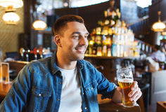 Happy man drinking beer at bar or pub Royalty Free Stock Image