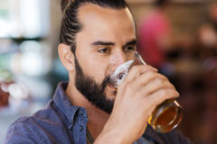 Happy man drinking beer at bar or pub Royalty Free Stock Photo