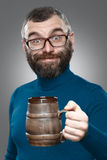 Happy man drinking beer from the mug Stock Photography