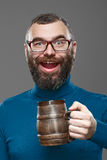 Happy man drinking beer from the mug Royalty Free Stock Image