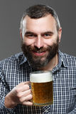 Happy man drinking beer from the mug Stock Images