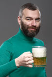 Happy man drinking beer from the mug Stock Image