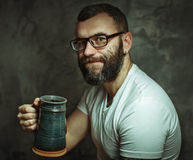 Happy man drinking beer from the mug Royalty Free Stock Images