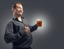 Happy man drinking beer from the mug Royalty Free Stock Photo