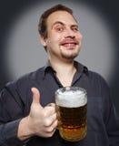 Happy man drinking beer from the mug Royalty Free Stock Photos
