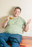 Happy man drinking beer Stock Photo