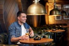 Happy man drinking draft beer at bar or pub Royalty Free Stock Photography