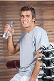 Happy Man Drinking Water From Bottle At Health Stock Photo