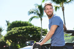 Happy man driver driving his new convertible car Stock Image