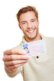 Happy man with drivers licence. Happy smiling man with his European drivers licence royalty free stock image