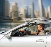 Happy man driving cabriolet car on city Royalty Free Stock Photos