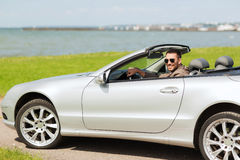 Happy man driving cabriolet car outdoors Royalty Free Stock Photos