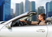 Happy man driving cabriolet car outdoors Royalty Free Stock Photo