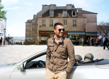 Happy man driving cabriolet car over city Stock Photo