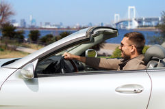 Happy man driving cabriolet car in tokyo Stock Images