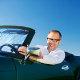 Happy man driving a cabriolet Royalty Free Stock Photos