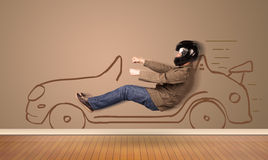 Happy man driving an hand drawn car on the wall Royalty Free Stock Image