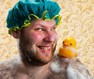 Happy man with duck toy Royalty Free Stock Photo