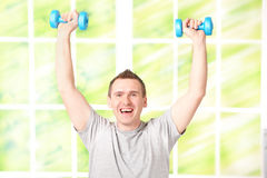 Happy man with dumbbells Royalty Free Stock Image
