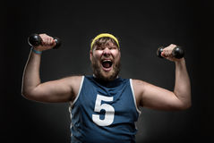 Happy man with dumbbells Royalty Free Stock Images
