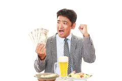 Happy man eating meals stock image