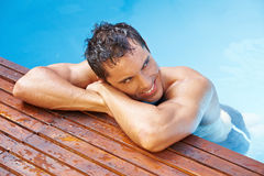 Happy man at edge of pool Royalty Free Stock Images