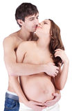 Happy man embrace pregnant woman Stock Images