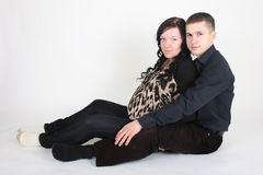 Happy man embrace pregnant woman Stock Photography
