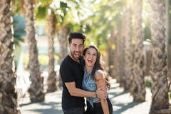 Happy man embracing girlfriend having fun Royalty Free Stock Image