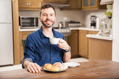 Happy man enjoying a cup of coffee Royalty Free Stock Photos