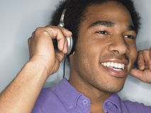 Happy Man Enjoying Music Stock Photography