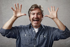 Happy man. Happy excited glad man with gesture hands royalty free stock photo