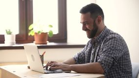 Happy man excited about win online looking at pc screen stock video