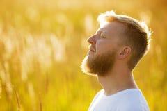 Happy man with eyes closed Stock Photo