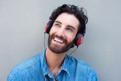 Happy man face smiling with headphones Stock Images