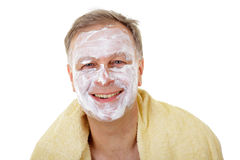 Happy man with facial mask. Royalty Free Stock Photography