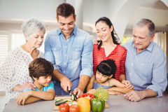 Happy man with family by kitchen table Stock Image