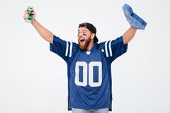 Happy man fan wearing number one fan glove drinking beer. Stock Image