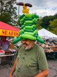 Happy Man at Farmer's Market Community Event Stock Image