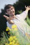 Happy man in field. By sunset Royalty Free Stock Photos