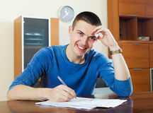 Happy man  fills in questionnaire Royalty Free Stock Photography