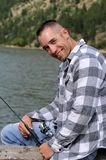 Happy man fishing Stock Image