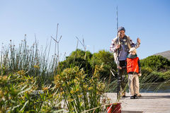 Happy man fishing with his son Stock Images