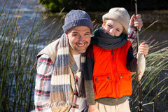 Happy man fishing with his son. Happy men fishing with his son in the countryside stock photo