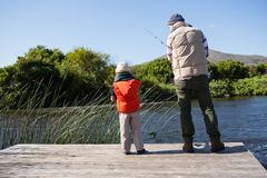 Happy man fishing with his son Royalty Free Stock Photos