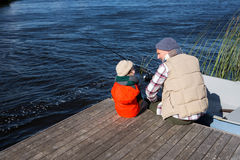 Happy man fishing with his son Royalty Free Stock Images