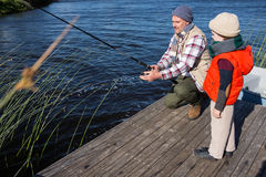 Happy man fishing with his son Stock Image